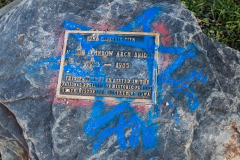 graffiti on historical marker Rainbow Briidge