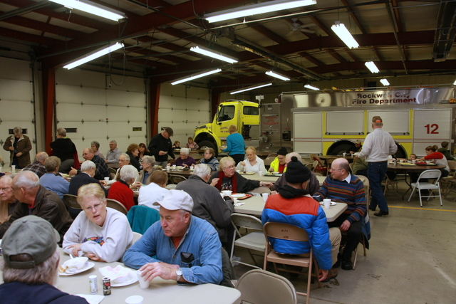 crowd enjoys soup at fire station