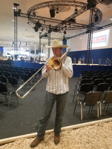 Farmer Derek from Kansas and his trombone, calling the cows