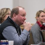 Happy meeting attendee in Iowa