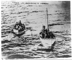 Survivors from the Titanic row towards the Carpathia